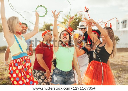 Brazilian Carnival. Group of Brazilian people in costume celebrating the carnival party in the city #1291169854