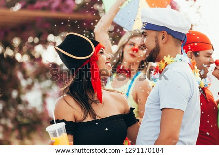 Brazilian Carnival. Couple in costume enjoying the carnival party in the city #1291170184
