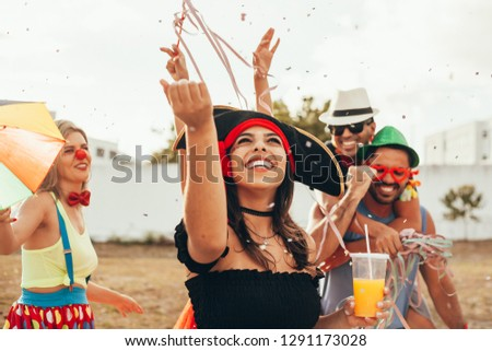 Brazilian Carnival. Group of Brazilian people in costume celebrating the carnival party in the city #1291173028