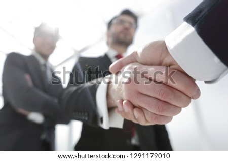 business background.business handshake #1291179010