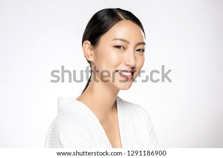 Beautiful Young asian Woman with Clean Fresh Skin look. Girl beauty face care. Facial treatment. Cosmetology, beauty and spa. #1291186900