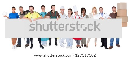 Group of diverse professionals presenting empty banner. Isolated on white