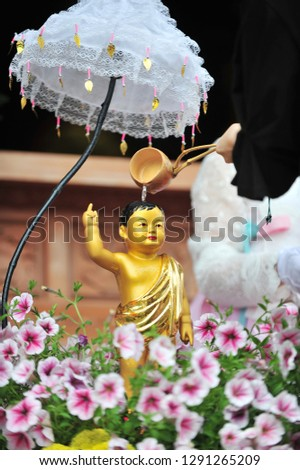 Pouring water onto a Buddha statue on the Buddha's birthday