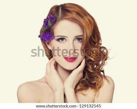 Redhead girl with flower, isolated. #129132545