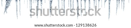 icicles which are hanging down from a roof. Seamless panorama isolated on white Royalty-Free Stock Photo #129138626