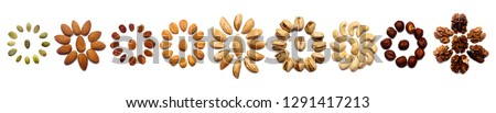A collection of nuts made from almonds, walnuts, hazelnuts, pistachios, cashews lie in the shape of a circle or the sun on an isolated white background with a clipping path. Various nuts pattern #1291417213
