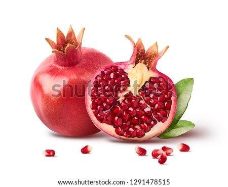 Fresh ripe pomegranate with green leaves isolated on white background. High resolution image #1291478515