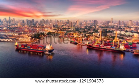 Logistics and transportation of Container Cargo ship and Cargo plane with working crane bridge in shipyard at sunrise, logistic import export and transport industry background #1291504573