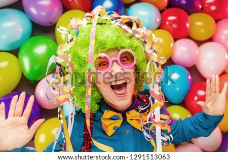 Portrait of beautiful party woman in wig and glasses (Carneval) #1291513063