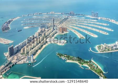 Aerial view of Dubai Palm Jumeirah island, United Arab Emirates #1291548640