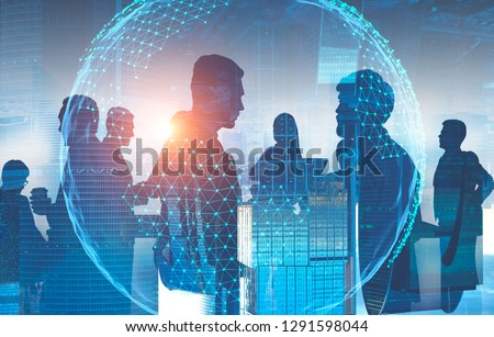 Silhouettes of business people discussing work and communicating with double exposure of cityscape and planet hologram. Global world concept. Toned image #1291598044