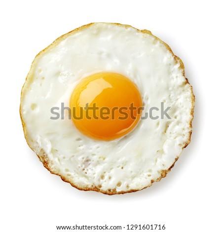 fried egg isolated on white Royalty-Free Stock Photo #1291601716