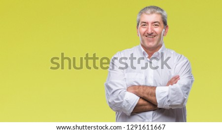 Handsome senior man over isolated background happy face smiling with crossed arms looking at the camera. Positive person. #1291611667
