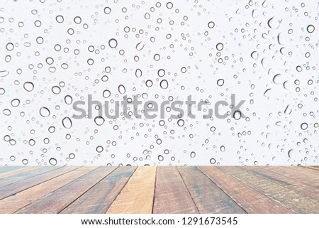 Water drops , Rain droplets on white background and empty wood desk .Blank space for text and images. #1291673545