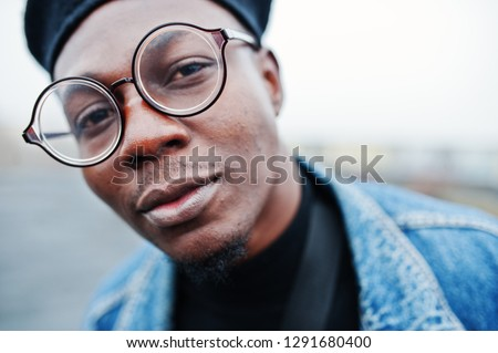 Close up portrait of african american man in jeans jacket, beret and eyeglasses. #1291680400