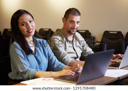 Cheerful multi-ethnic business team working on design project in office #1291708480