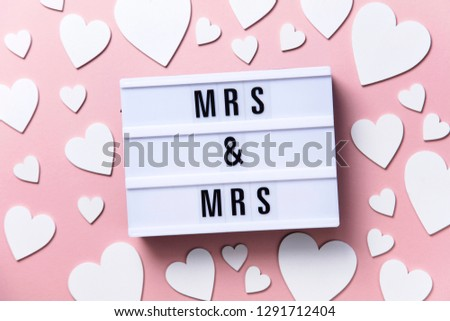 Mrs and Mrs lightbox message with white hearts on a pink background #1291712404