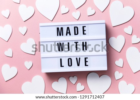 Made with love lightbox message with white hearts on a pink background #1291712407