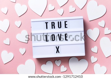 True love lightbox message with white hearts on a pink background #1291712410