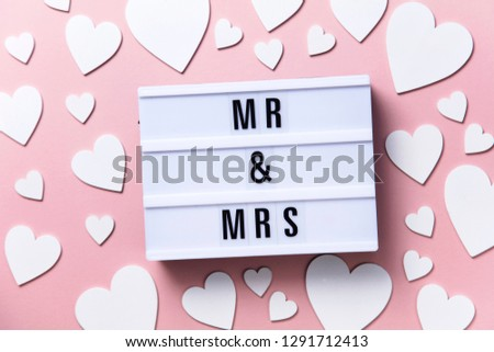 Mr and Mrs lightbox message with white hearts on a pink background #1291712413