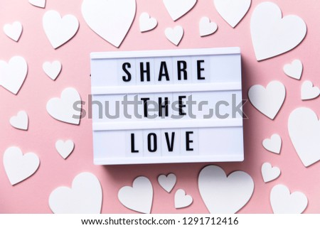 Share the Love lightbox message with white hearts on a pink background #1291712416
