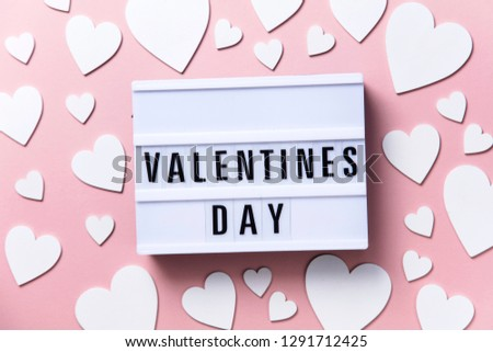 Valentine's day lightbox message with white hearts on a pink background #1291712425