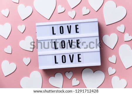 Love lightbox message with white hearts on a pink background #1291712428