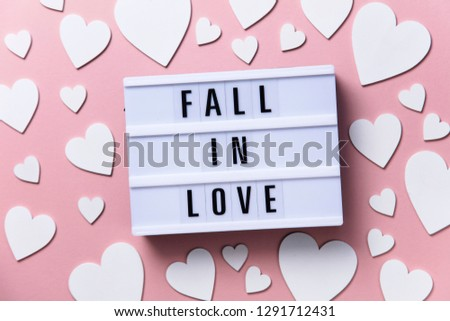 Fall in Love lightbox message with white hearts on a pink background #1291712431