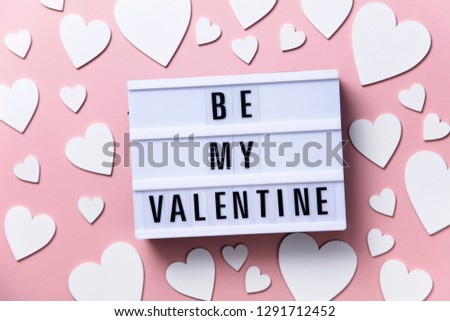 Be My Valentine lightbox message with white hearts on a pink background #1291712452