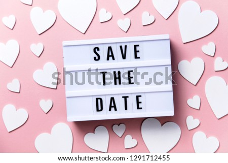 Save the date lightbox message with white hearts on a pink background #1291712455