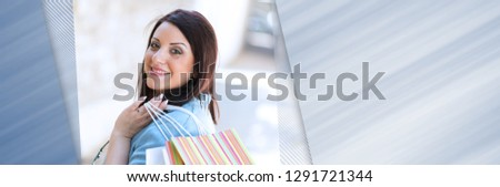 Pretty young woman walking with shopping bags in hand. panoramic banner #1291721344