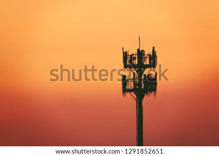 Sunset and Tall mast with cellular antenna #1291852651