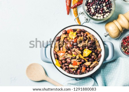 Chili con carne in a pot. Top view, space for text. #1291880083