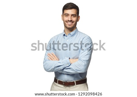 Handsome smiling business man in blue shirt standing with crossed arms, isolated on white background #1292098426
