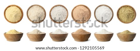Set of organic flour in wooden bowls on white background #1292105569