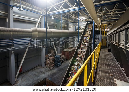 moving conveyor transporter on Modern waste recycling processing plant. Separate and sorting garbage collection. Recycling and storage of waste for further disposal.  #1292181520