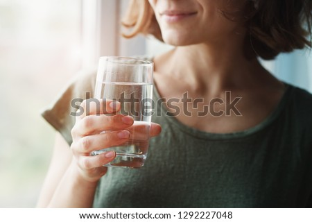 healthy beautiful young woman holding glass of water  #1292227048