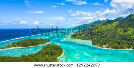 Panorama aerial view of tropical islands in the middle of the turquoise lagoon and exotic mountains, Moorea, Tahiti French Polynesia #1292242099