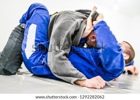 Brazilian Jiu jitsu Training, lapel Choke #1292282062