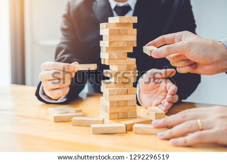 Businessman plan and strategy in business Domino Effect Problem Solving #1292296519
