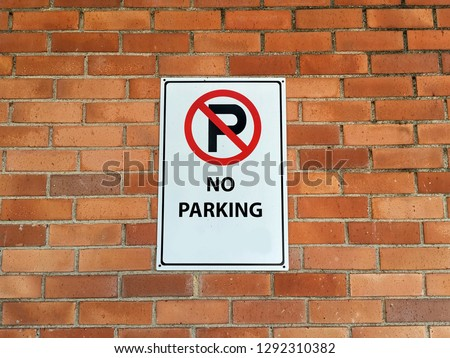 no parking sign on the bricks wall