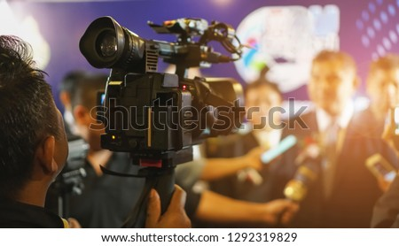 cameraman recording. videotaping microphone journalist journalist interviewing. live streaming concept. #1292319829