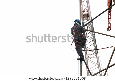 Worker wear safety harness on high with scaffolding and structure steel for safety concept isolated on white background. #1292381509