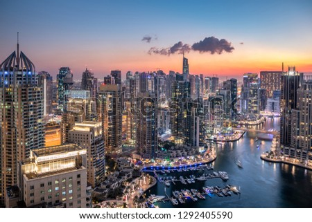Panoramic view of famous Dubai skyline. Skyscrapers of modern city and glittering night lights
