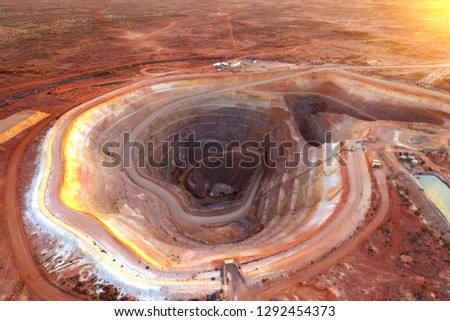Open cut gold mining operation in remote Australia showing pit and spoil piles #1292454373