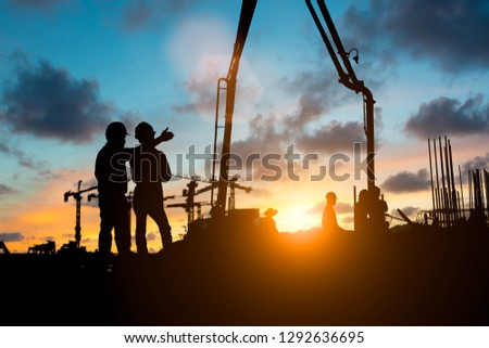 Silhouette of engineer and construction team working at site over blurred background for industry background with Light fair. #1292636695