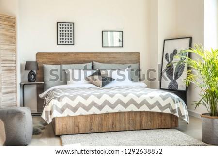Interior of modern comfortable bedroom #1292638852