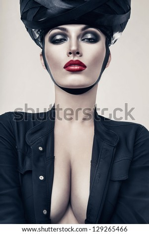 hot woman in jacket and hat #129265466