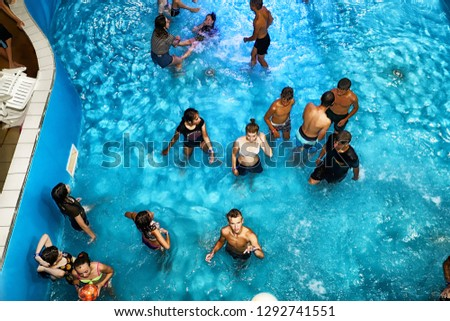 Kirov, Russia - August 19, 2018: Teenagers on party AQUA MADFLOW at Russia in Kirov city in AquPark named Friendship #1292741551
