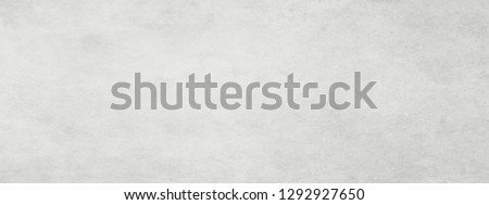 Long wide white light panoramic wallpaper. Monochrome texture background with white and gray color.Grunge old wall texture, concrete cement #1292927650
